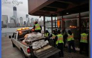 The One World Trade Center is seen in the background as workers place ...