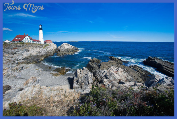 Rocky Shoreline With Lighthouse Portland Head Main by George Oze