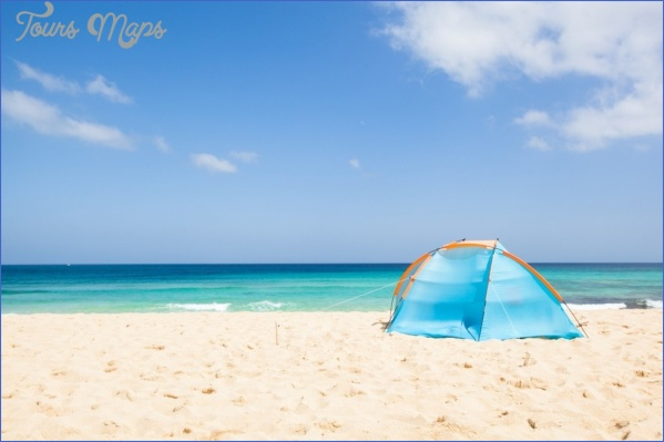 things to do in the canary islands camping with a tent at a lonesome beach with a turquoise sea and blue sky in the background fuerteventura canary islands spain europe 827 8790 ssl1 Best Travel Destinations For Young Couples