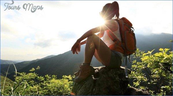 hiking girl on top of mountain 2048x progressive 08b12938 f5dd 49e3 ae5a 698fa86b93b8 1400x progressive v1516234951 What To Pack For Your Fall Hiking Adventure
