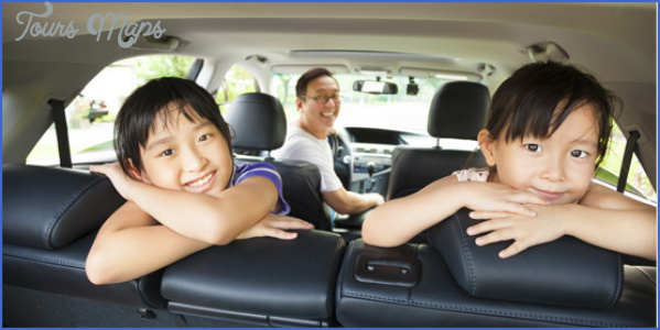two girls arms crossed back seat car preparing family road trip h275w552 How to Prepare Your Vehicle for a Long Trip?