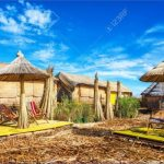 32164498 houses and umbrellas made out of reeds on uros floating islands on lake titicaca near puno peru 150x150 PUNO PERU   Man Made Islands