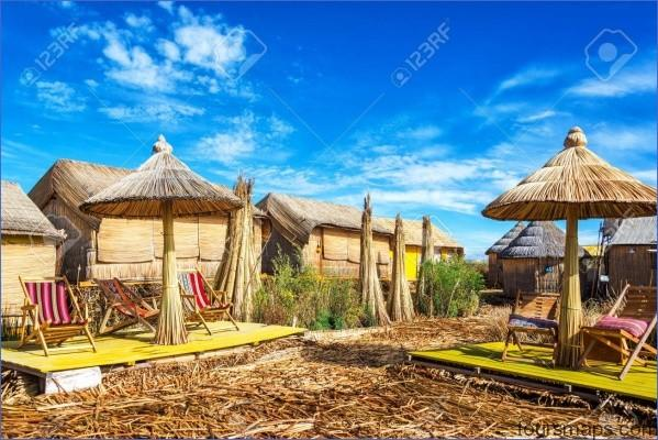 32164498 houses and umbrellas made out of reeds on uros floating islands on lake titicaca near puno peru PUNO PERU   Man Made Islands