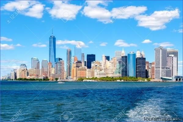 66299016 the lower manhattan skyline in new york city seen from the ocean on a sunny summer day A DAY in NEW YORK