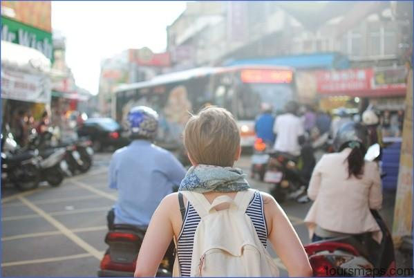 city people woman street Budget Travel Spending Wisely on the Road