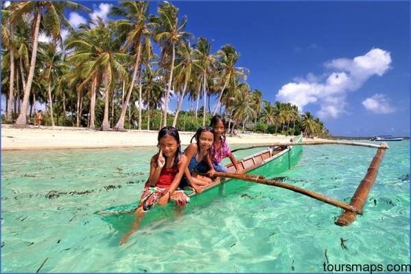 why you should travel to the philippines photo kids in siargao philippines sabrina iovino via just1wayticket PERFECT DAY IN SIARGAO   BEST OF THE PHILIPPINES