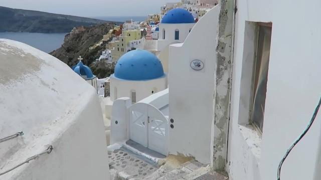 blue doors in oia santorini 24 How to Travel in Santorini